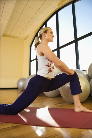 Woman stretching at gym.
